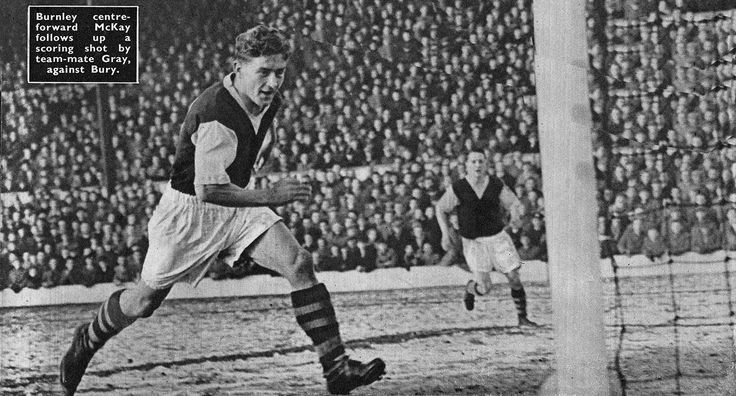 10th January 1956. Burnley centre forward Peter Mckay follows up on a shot from team mate Billy Gray to score against Bury, at Gig Lane.