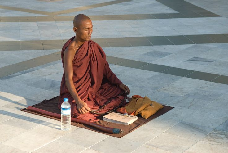 A monk in Shwedagon pagoda in Yangoon - Yangon, Yangon