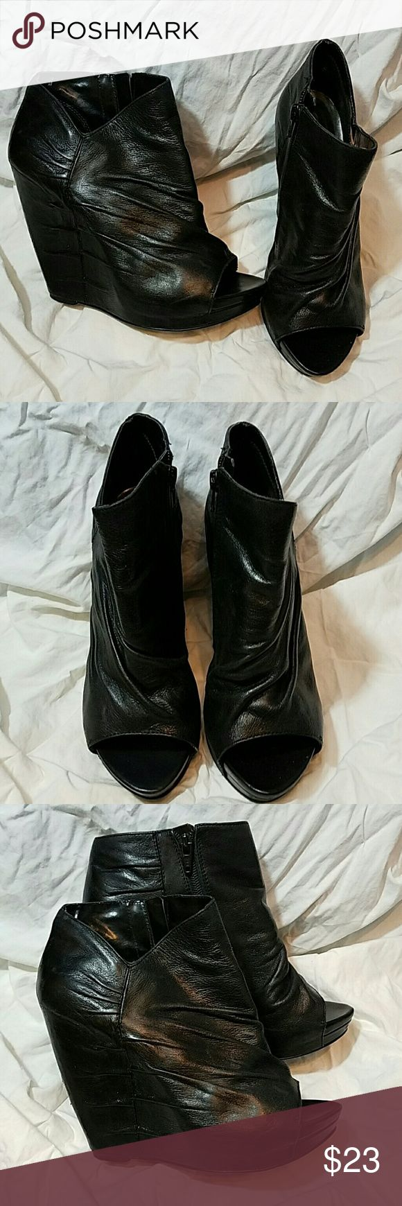 CARLOS Black 'Camino' Peep Toe Wedge Booties CARLOS by Carlos Santana Black 'Camino' Peep Toe Wedge Booties. Great condition, wear noted in photos.    Size 7.5 Carlos Santana Shoes