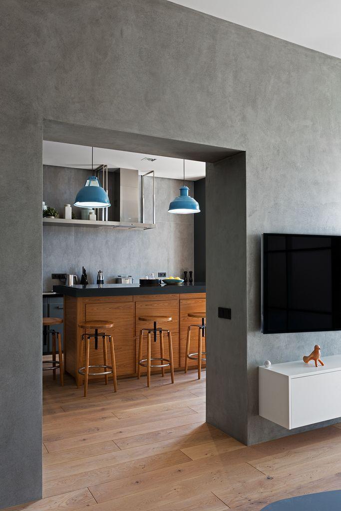 Серые оштукатуренные стены - это именно то чего ожидаешь от интерьера в стиле…
