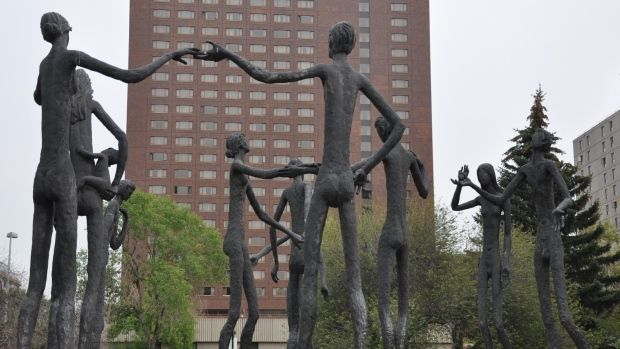 The Mario Armengol sculpture, The Brotherhood of Mankind, is seen outside the Calgary Board of Education offices.