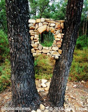 Jaime Filipe, Portuguese Land Artist. This beautiful arch on the edge of a river shows just how wonderful natural materials and gravity work together.