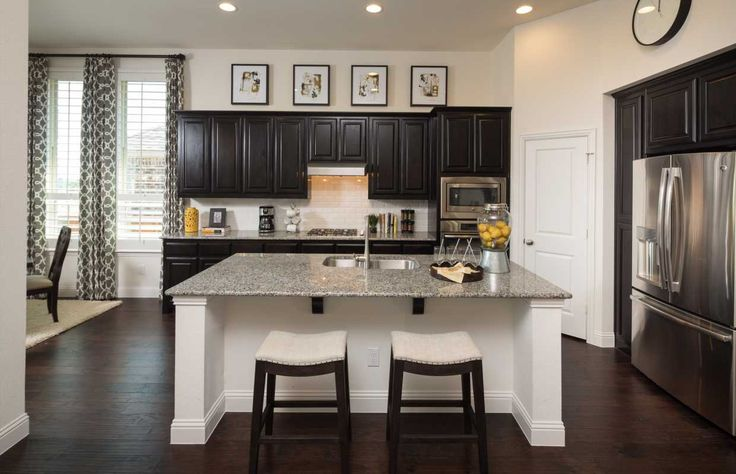 Open Concept Kitchen Of 1602 Emerald Bay Lane Highland Homes Model Home At  Inspiration Texas In