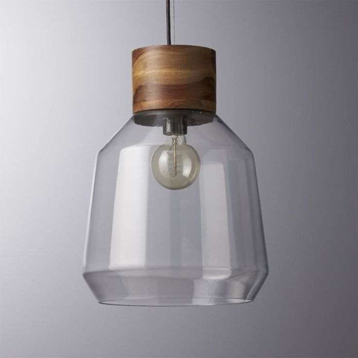 Shop loft pendant light.   Earthy mix of materials captures a soft glow capped by the warmth of wood.