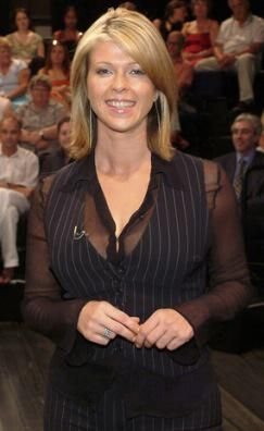 Kate Garraway. Those buttons aren't going to last long. Looks like the top one has already gone.