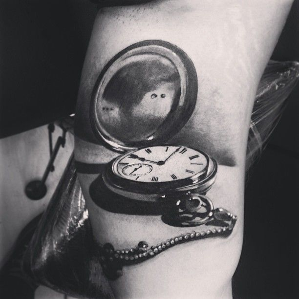 From Venezuelan artist Yomico Moreno. I love the black and grey, the 3-D photorealism, and the watch image itself. yomicoart.com