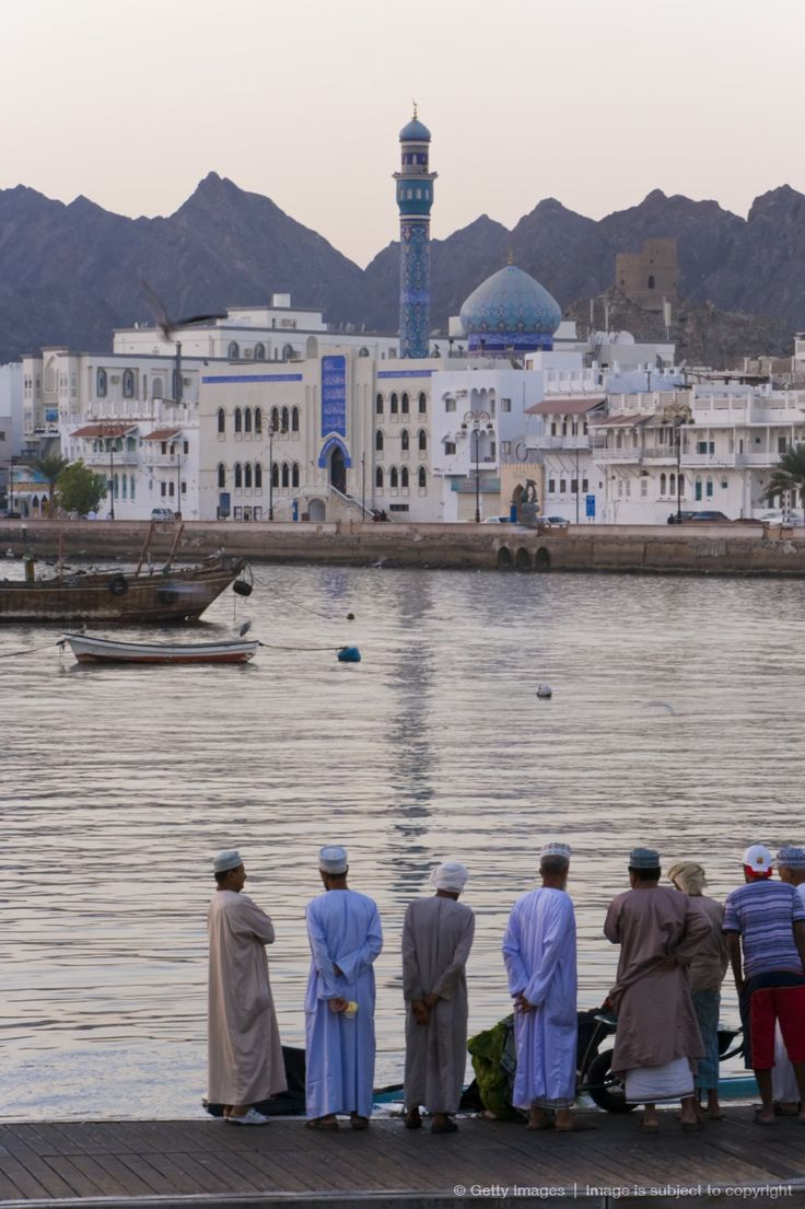 #Oman, Muscat, Fish market and city skyline