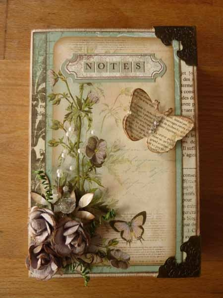 Love the butterfly out of old book page.  Possibly cut one of them down the middle and layer the other on top instead of using two different punches/dies,