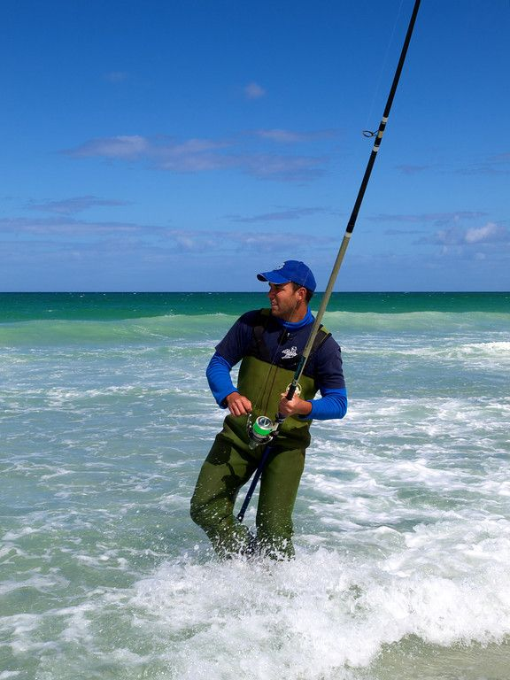 Chad Prentice surfcasting at Great Exhibition Bay, Northland.