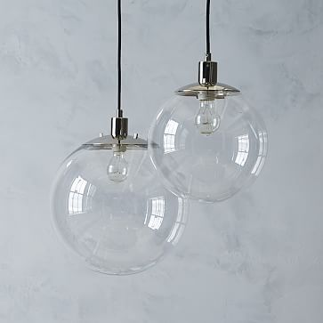 "Globe Pendant - Clear #westelmDETAILED SPECIFICATIONS   Small Globe: 11""diam. x 11""h. Large Globe: 14""diam. x 14""h. Ceiling plate: 5""diam. x 1""h. Cord length: 116""l (adjustable upward). Accommodates a 13W CFL bulb or a 60W incandescent bulb (not included)."