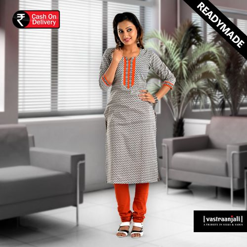 This printed kurti in cotton has an orange taping around the neckline and ¾ sleeves. The combination is electric and has in it to fetch you compliments.  Visit www.vastraanjali.com for online shopping.
