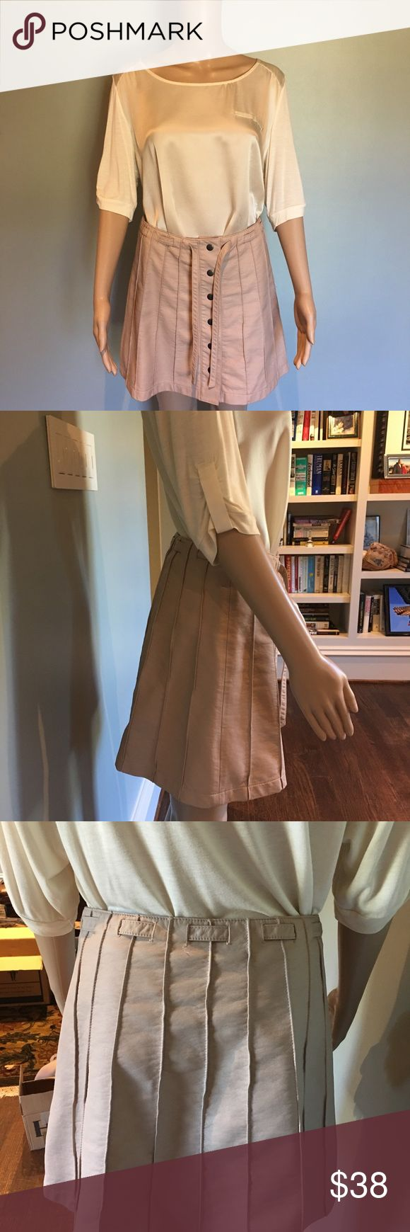 """Free People faux leather snap skirt Perfect condition. *vest & top also for sale; see listings* FIRM PRICE  Macy's: """"No closet staple is more covetable than the feminine-meets-tough faux leather skirt, and Free People has upped the ante with its flattering version. A snap front adds retro-cool appeal, while stitched pleat-effect panels enrich the A-line silhouette with texture. Ties at waist, snap front, stitched pleat-effect panels, lined Approx. 15"""" from waist to hem based on a size 2…"""