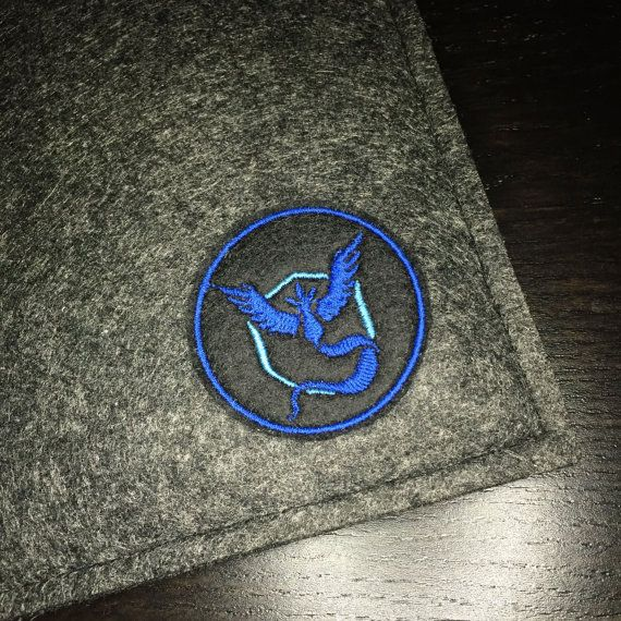 What better way to show pride for your team than to have a Team Mystic patch! This premium patch embroidered with vivid colours on a durable felt base. It measures approximately 2.0 x 2.0  This patch can be sewn or ironed on to your favorite knapsacks, jeans or jackets. For removable options, choose our pin backed version that has a bar pin fastened to the back.