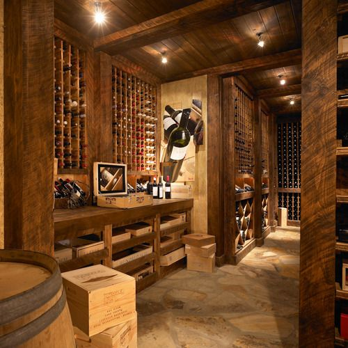 Great ceiling and flooring choice in this wine cellar for Wine cellar in house