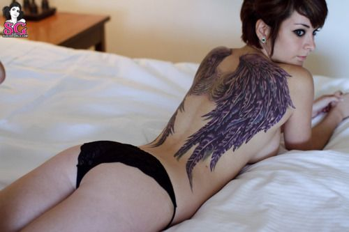I love wing tattoos although I would probably never get one.