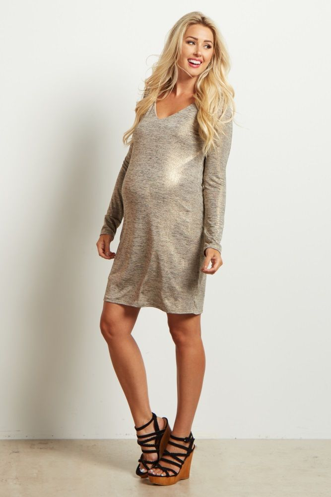 Rock this cool metallic maternity dress on a night out! This shiny, contemporary dress is everything you need to freshen up your style. This silky-smooth material will keep you cool and comfortable. For a date night look, pair this maternity dress with strappy black heels and a simple necklace.