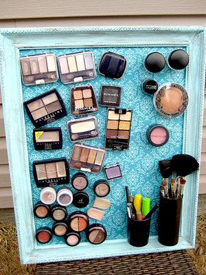 Considering doing this to the medicine cabinet...although I may need a floor length one for all of the makeup. :) For all gals with small apartments! This is genius! DIY decorative metal, framed and then add tiny magnets to your cosmetics and voila, you have just cleared off your bathroom counter/bedroom dresser AND added art to your wall!