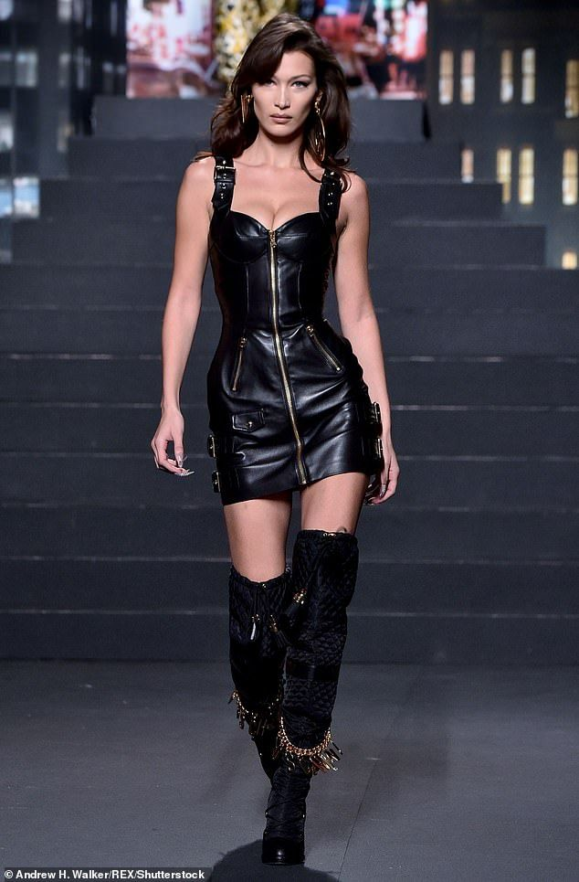 4d3eb2d9ee4 Bella Hadid sizzles in leather mini-dress on Moschino X H&M catwalk ...