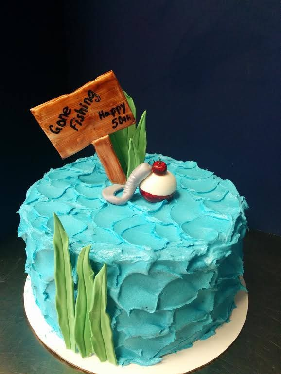 Gone fishing cake with a bobber and hook for a 50th birthday. Also great as a retirement cake!