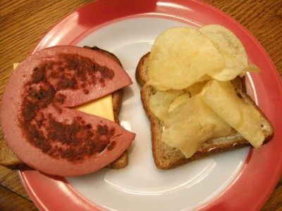Fried Bologna sandwich with Lays original potato chips on one side - mayo and mustard and a pickle