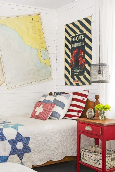 Guest Bedroom:  When it comes to styling, Mary Kay says she gets inspiration from vignettes at antiques shows. Proof: the casually crooked vintage nautical charts that hang above a vintage twin bed, which was gifted by a dear friend.