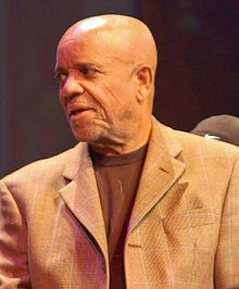 Berry Gordy's successful Tamla/Motown group of labels was notable for being black-owned, unlike most of the earlier independent R labels. Notable artists under this label were The Supremes, The Temptations, Smokey Robinson and the Miracles, the Four Tops, Marvin Gaye, Tammi Terrell, Martha and the Vandellas, and The Jackson Five. Hits were made using a quasi-industrial production-line approach. Some considered the sound to be mechanistic but producers and songwriters such as;