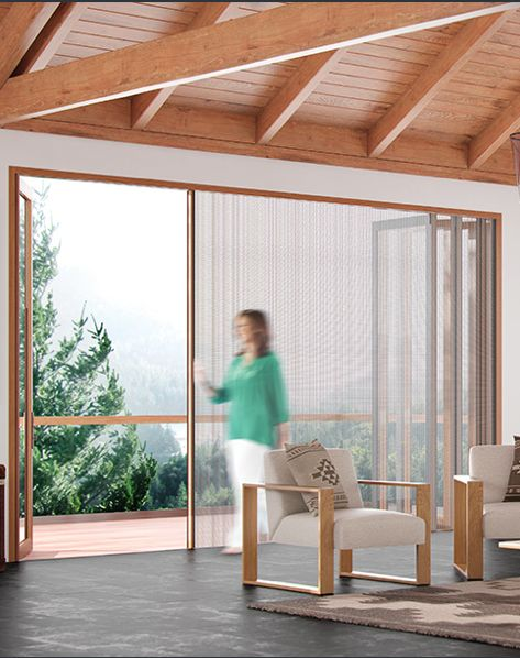 Centor Door Systems: You'll notice no visual barriers between you and the outdoors. That's because we've designed our doors with clean, narrow panel frames, plus concealed door hinges and locking devices to avoid distraction. Aluminum-wood clad doors combine the warmth of wood inside with low-maintenance, paintable aluminum outside for beauty and functionality.