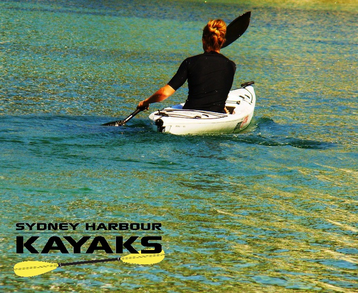 Top Aussie Paddler Candice Falzon in the beautiful Blue waters of Middle Harbour Sydney