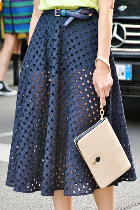 Perfect the knotting of a belt for an artistic accent on your ensemble.