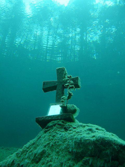 Underwater cross at Sameranger Lake in Tyrol, Austria