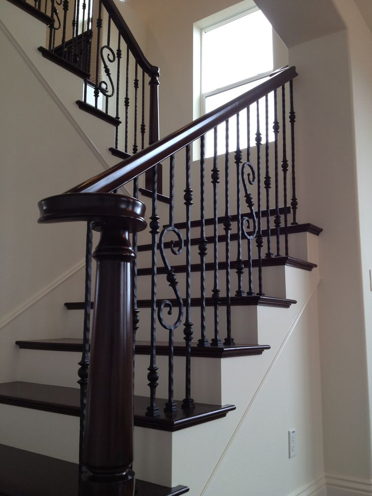 dark floors wrought iron stairs