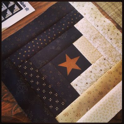 what a great color combination! And an interesting variation on a log cabin. The cornerstone square looks to be fussy cut and if done in all the blocks would make a very patriotic looking quilt.