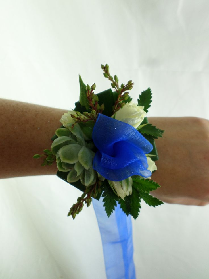 Ball corsage with a ribbon tie. Made with roses and succulents. Created by Florist ilene
