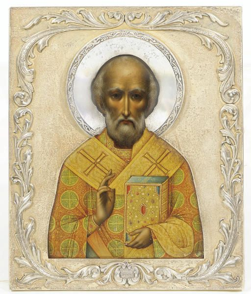 St. Nicholas The Miracle-Worker – Russian, The silver-gilt oklad with the mark of Karl Faberge, (K.Faberge struck incuse in Cyrillic), with the Imperial warrant, 1908-17 The saint portrayed half-length, frontal, blessing & holding the Book of Gospels, the latter with a luxurious binding emulating gold & stone-encrustation, his face depicted realistically with soft shades, his phelonion opulently decorated with crosses, on light green ground, 10 5/8 x 8 7/8 in.