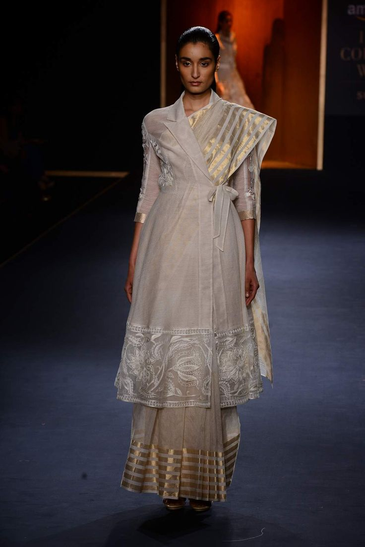 White embroidered overlapped trench jacket with ivory handwoven sari available…