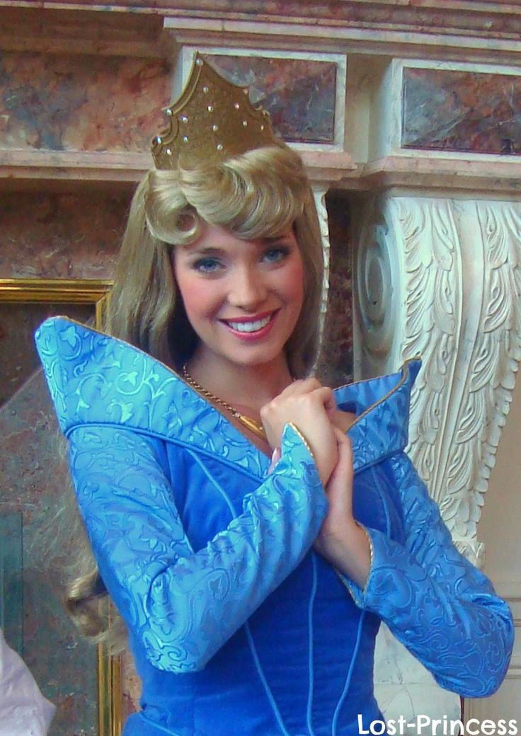 Aurora, in her blue dr...