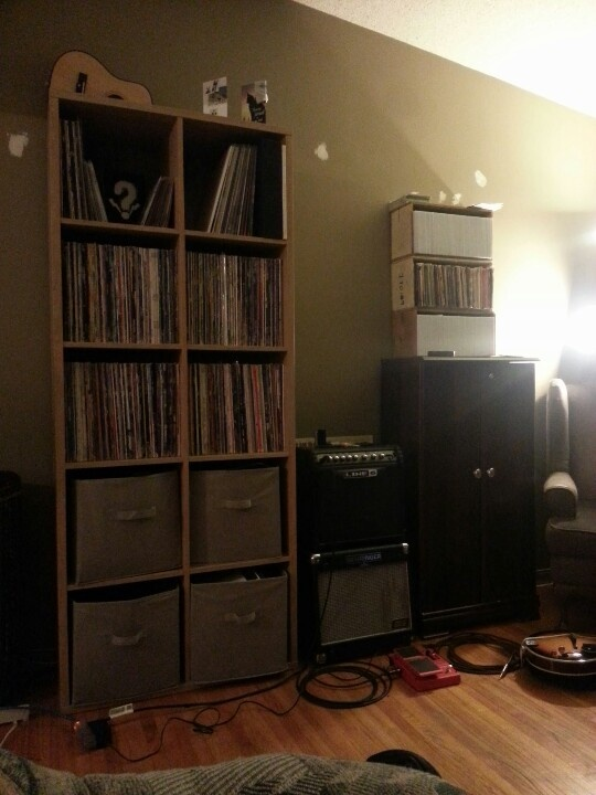 """My record collection. 45's to the right on top of a CD cabinet. A few more 45's in the top left cube along with 12""""singles."""