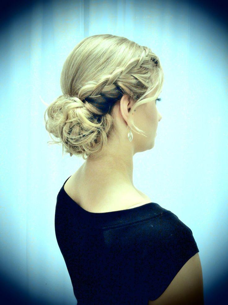 Curly bun with side braid by Parturi-kampaamo Salon Maria/Emmi