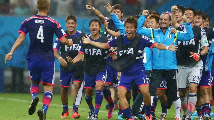 Keisuke Honda of Japan (L) celebrates 2014 FIFA World Cup™