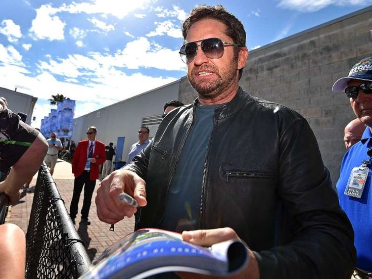 Best of the 2016 Daytona 500:     Gerard Butler signs autographs before the Daytona 500.