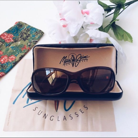 "FLASH SALE Authentic Maui Jim ""Lagoon"" Women sunglasses. Worn once and has been stored in its original case. The lenses are in perfect conditions, no scratches and the plastic frames are not bent or stretched. Only thing is the storage case liner is coming off but you can glue the liner to the case itself. Sunglasses are in perfect conditions. 100% UV protection, PolarizedPlus 2 Lens technology to reduce glare, lightweight, has silicone nose pads for no-slip comfort. Brown lenses, brown…"