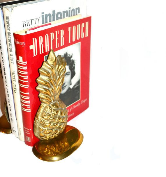 Beautiful pair of brass pineapple bookends. These would be great for an office, library or your living room. Bookends are hollow in the center, but