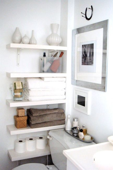 """Good idea for small bathrooms - shelving in that """"dead space"""" area between the toilet & the wall."""
