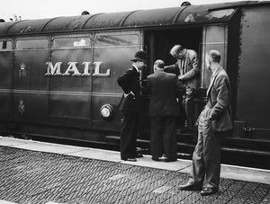 Police examining one of the coaches on the Glasgow to London travelling post office train near Bridego Railway Bridge in Buckinghamshire, England, the morning after the train was attacked and robbed in the 2.6 million pound 'Great Train Robbery', 8th August 1963.