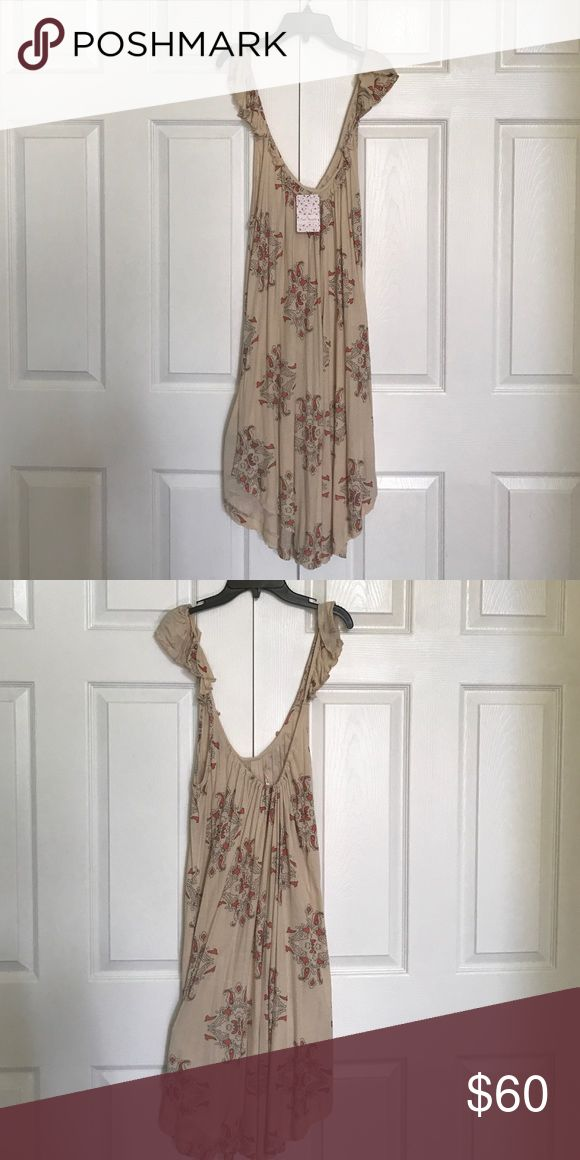 Brand new Free People summer dress Brand new Free People cream summer dress with simple paisley pattern. Slits on both sides. No zipper. Loose and comfy fit. Free People Dresses