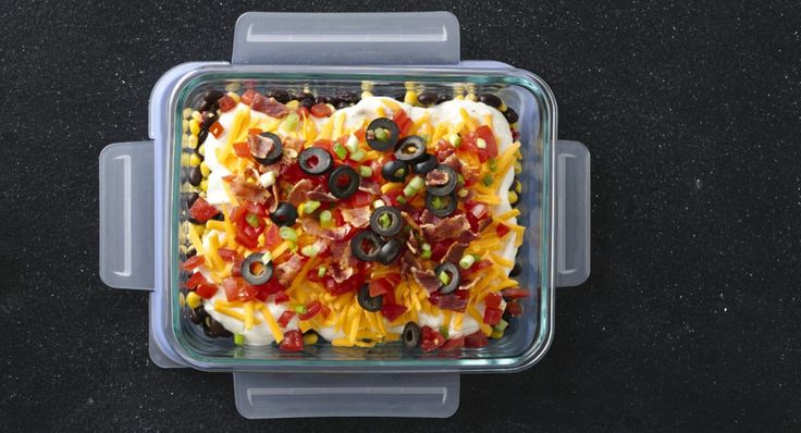Cowboy Layered Dip recipe - A mega flavor medley, including black beans, seasoned sour cream, crisp bacon and fresh tomatoes.