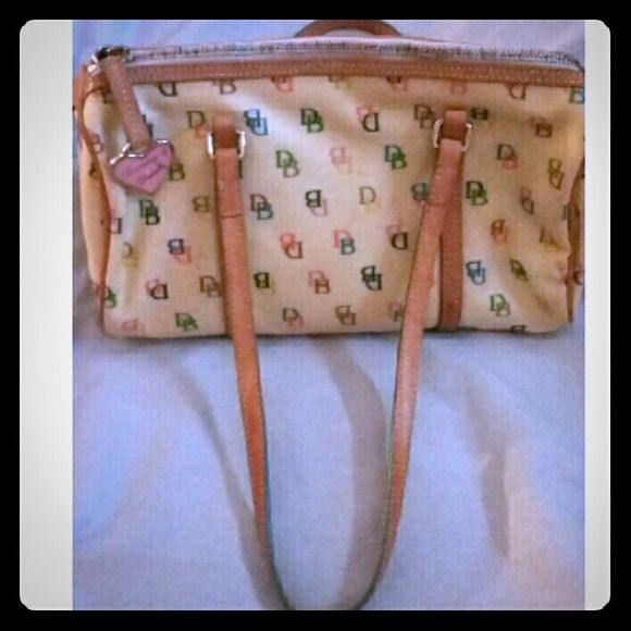 Dooney and Bourke Rainbow barrel bag. Used Vintage Dooney and Bourke's rainbow collection barrel bag. Purchased in 2004 at Dillard's department store. Preloved and Good used condition. Pictures and price reflects all normal wear, lots of life left. Bag is stuffed with paper. No dust bag. Will consider all reasonable offers but priced to sell! Dooney & Bourke Bags Shoulder Bags