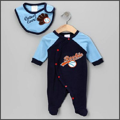 Baseball Rookie - 2 Piece. Just perfect for your little star! This 2 piece baseball themed set by Mon Cheri Baby features a blue romper with a sweet matching 'Cutest Ever' bib. Made of 100% cotton, your little sports star is sure to be as comfy as ever!