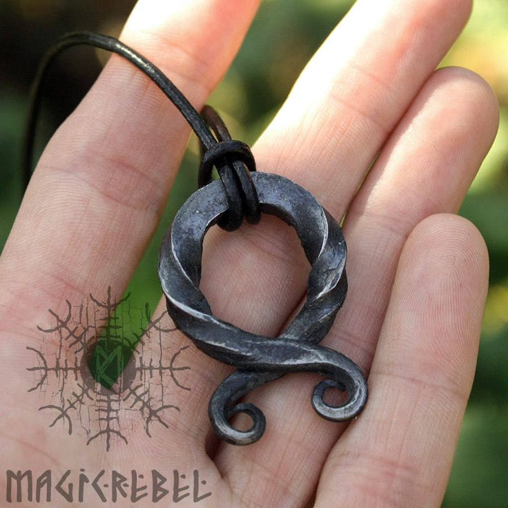 This is a forged iron twisted handmade Viking style pendant. The pendant is an ancient Vikings symbol Troll Cross that was used as an amulet or protection symbol to guard against trolls and evil spirits. Pendant length is about 1.3-1.5 inches or 35-40mm, but size varies. Pendant comes on a black l