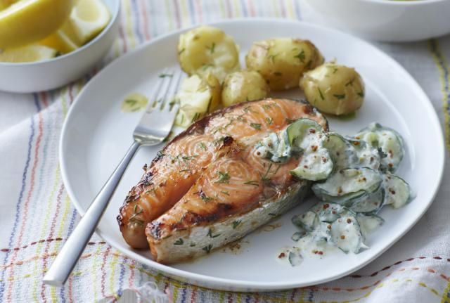 In this recipe, salmon steaks are baked to perfection with a combination of lemon juice, dill, and sour cream.